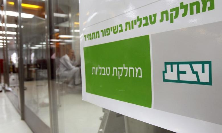 A sign bearing the logo of Teva Pharmaceutical Industries is seen in its Jerusalem oral solid dosage plant (OSD) December 21, 2011.   REUTERS/Ronen Zvulun