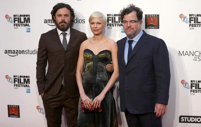 Actors Casey Affleck (L), Michelle Williams (C) and director Kenneth Lonergan poses for photographers at a Gala screening of their film ''Manchester by the Sea'' at the 60th BFI London Film Festival in London, Britain October 8, 2016. REUTERS/Neil Hall/File Photo