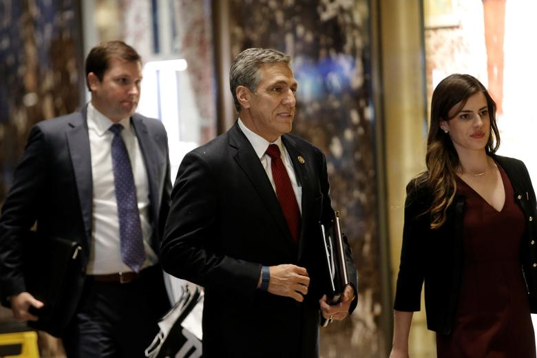 U.S. Representative Lou Barletta (R-PA) is escorted by Madeleine Westerhout as he arrives at Trump Tower to meet with U.S. President-elect Donald Trump in New York, U.S., November 29, 2016.   REUTERS/Mike Segar