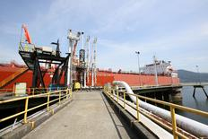 A tanker docks at Westridge Terminal, the loading area for Kinder Morgan's Trans Mountain pipeline in Burnaby, British Columbia, Canada in a May 10, 2013 file photo. Kinder Morgan Canada/Handout via REUTERS