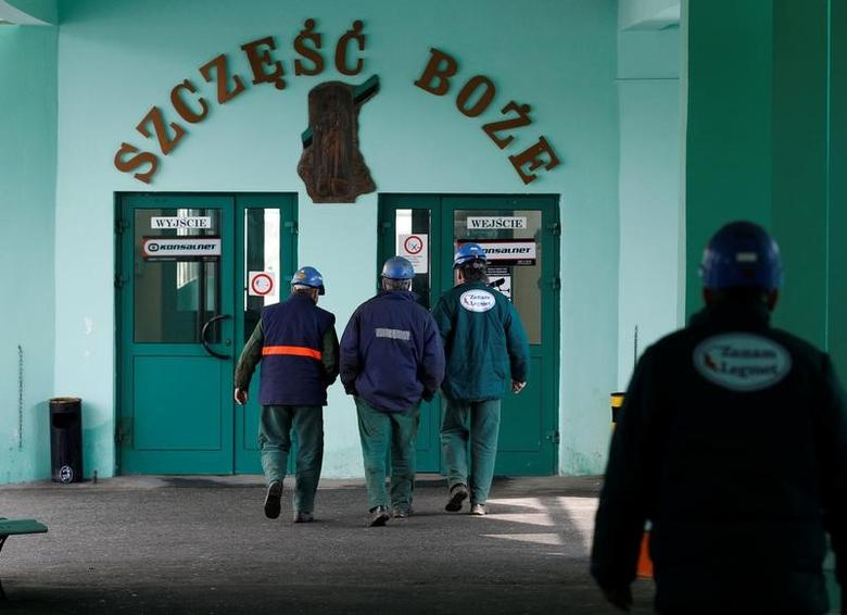 Miners arrive at the Rudna copper mine in south Poland March 20, 2013.Picture taken March 20, 2013. REUTERS/Peter Andrews/File photo