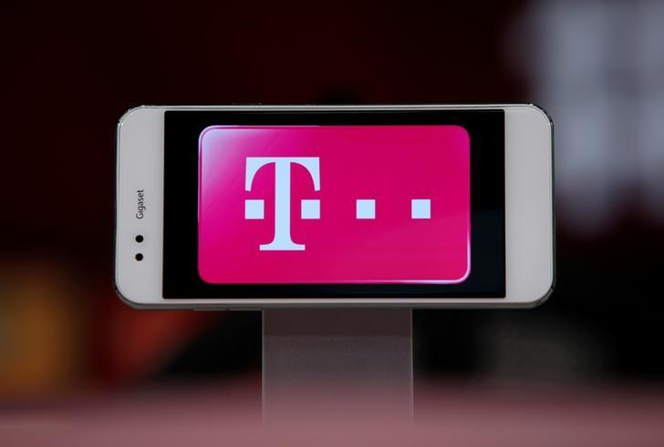 Logo of German telecommunications giant Deutsche Telekom AG is seen on a Gigaset mobile during a news conference of Bayern Munich in Munich, Germany August 6, 2016.     REUTERS/Michaela Rehle/File Photo