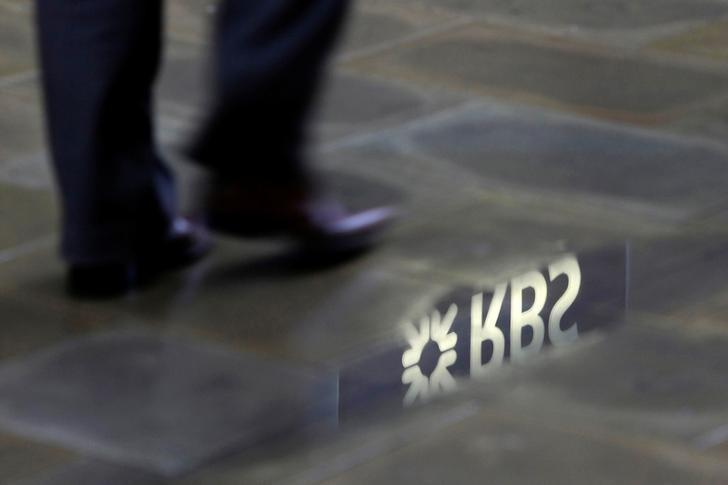 A man walks past a  Royal Bank of Scotland branch reflected in a puddle in central London January 14, 2010.   REUTERS/Stefan Wermuth/File Photo               GLOBAL BUSINESS WEEK AHEAD PACKAGE - SEARCH 'BUSINESS WEEK AHEAD 24 OCT'  FOR ALL IMAGES
