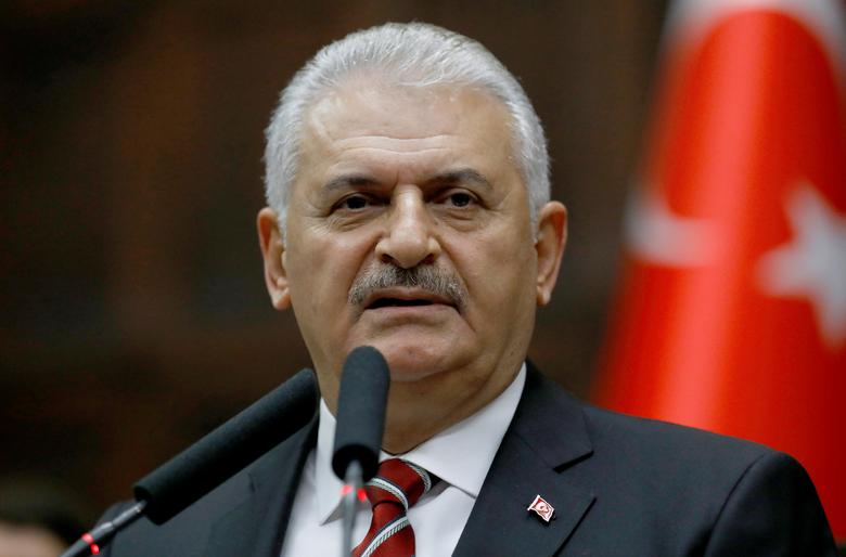 Turkey's Prime Minister Binali Yildirim addresses members of parliament from his ruling AK Party (AKP) during a meeting at the Turkish parliament in Ankara, Turkey, November 8, 2016. REUTERS/Umit Bektas