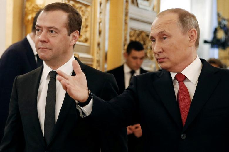 Russian President Vladimir Putin and Prime Minister Dmitry Medvedev walk after the president delivered his annual state of the nation address at the Kremlin in Moscow, Russia December 1, 2016. Sputnik/Pool/Dmitry Astakhov