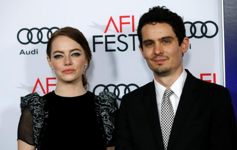 Director Damien Chazelle and cast member Emma Stone pose at the premiere of ''La La Land'' during AFI FEST in Hollywood, California U.S., November 15, 2016. REUTERS/Mario Anzuoni