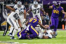 Dec 1, 2016; Minneapolis, MN, USA; Dallas Cowboys quarterback Dak Prescott (4) is sacked during the fourth quarter against the Minnesota Vikings at U.S. Bank Stadium.  Mandatory Credit: Brace Hemmelgarn-USA TODAY Sports