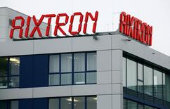 The logo of Aixtron SE is pictured on the roof of the German chip equipment maker's headquarters in Herzogenrath near the western German city of Aachen, October 25, 2016.  REUTERS/Wolfgang Rattay