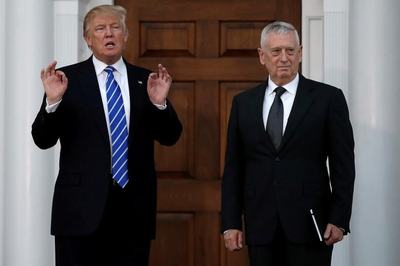 FILE PICTURE: U.S. President-elect Donald Trump stands with retired Marine Gen. James Mattis following their meeting at the main clubhouse at Trump National Golf Club in Bedminster, New Jersey, U.S., November 19, 2016.  REUTERS/Mike Segar/File Photo