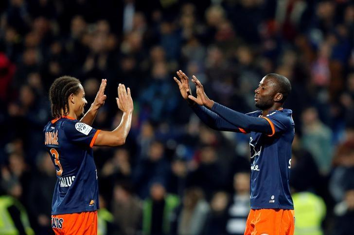 Football Soccer - Montpellier v Paris St Germain - French Ligue 1 - Mosson stadium, Marseille, France 03/12/2016 - Montpellier's Daniel Congre (L) and Cedric Moncongu react at the end of their match against Paris St Germain.  REUTERS/Jean-Paul Pelissier