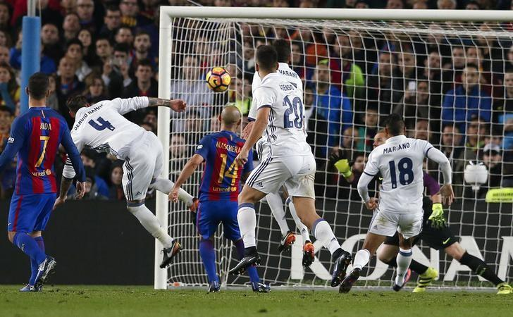 Football Soccer - Barcelona v Real Madrid - Spanish La Liga Santander- Nou Camp Stadium, Barcelona, Spain - 3/12/16. Real Madrid's Sergio Ramos scores a goal during the ''Clasico''.    REUTERS/Albert Gea