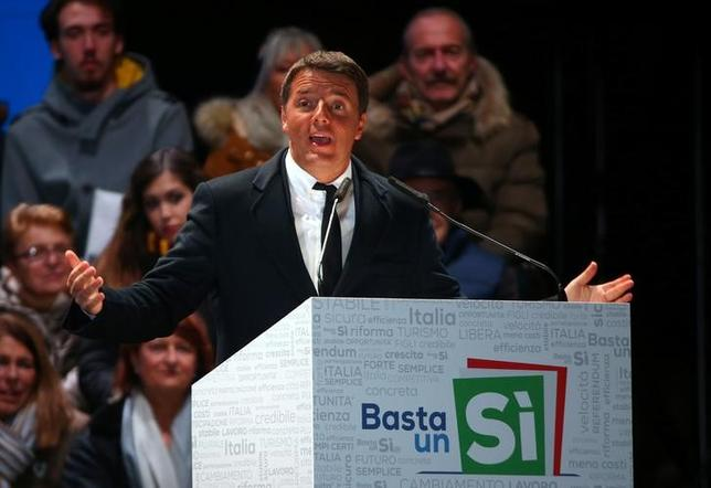 Italian Prime Minister Matteo Renzi speaks during the last rally for a ''Yes'' vote in the upcoming referendum about constitutional reform, in Florence, Italy, December 2, 2016. REUTERS/Alessandro Bianchi