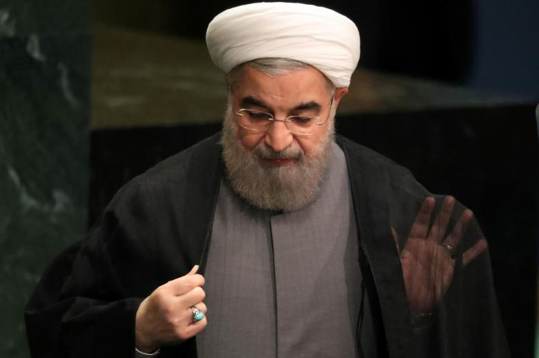 Iran's President Hassan Rouhani adjusts his clothes after he addressed the 71st United Nations General Assembly in Manhattan, New York, U.S. September 22, 2016. REUTERS/Carlo Allegri