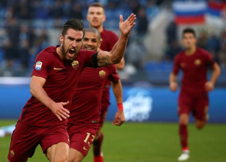 Football - Soccer - Lazio v AS Roma - Italian Serie A - Olympic Stadium, Rome, Italy - 4/12/2016. AS Roma's Kevin Strootman (L) celebrates after scoring. REUTERS/Alessandro Bianchi