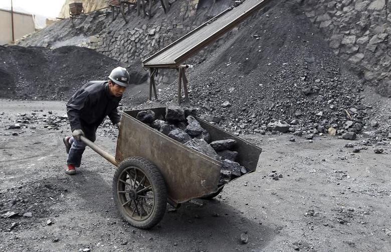 A worker pushes a cart at a coal mine owned by Puda Coal Inc. in Pinglu, Shanxi province March 24, 2011.  REUTERS/Stringer