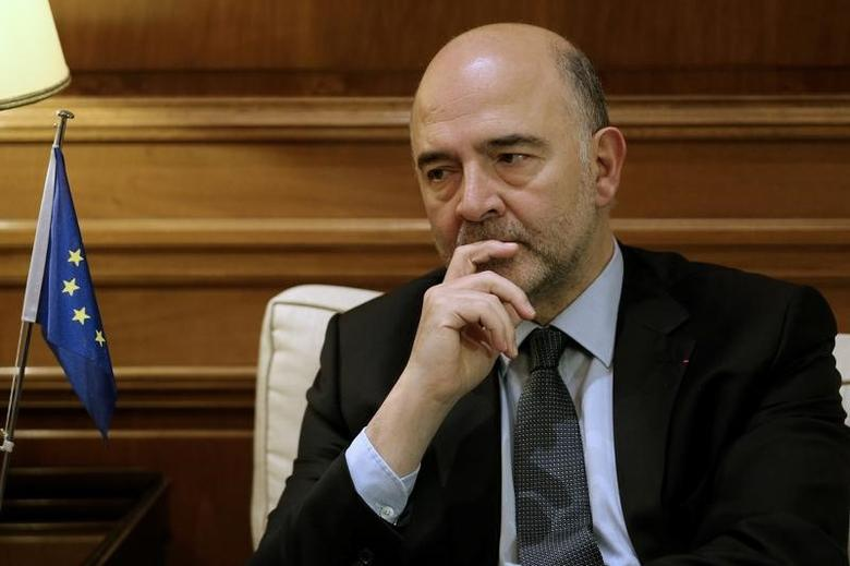 European Economic and Financial Affairs Commissioner Pierre Moscovici meets with Greek Prime Minister Alexis Tsipras (not pictured) at the Maximos Mansion in Athens, Greece,  November 28,  2016. REUTERS/Michalis Karagiannis