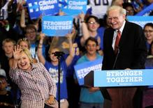 U.S. Democratic presidential candidate Hillary Clinton waves to supporters as she is introduced by Warren Buffett during a campaign rally at the Omaha North High Magnet School in Omaha, Nebraska August 1, 2016. REUTERS/Dave Kaup