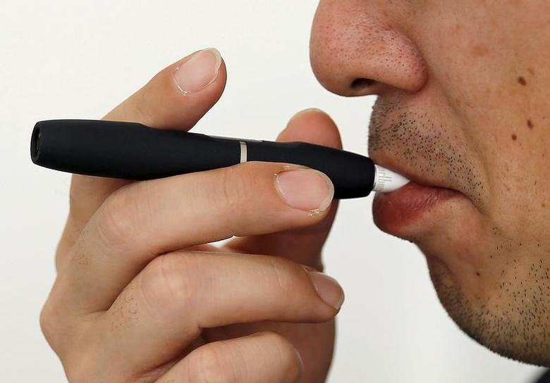 A customer tries a Philip Morris' ''iQOS'' smokeless tobacco e-cigarette at an iQOS store in Tokyo, Japan on March 3, 2016.  REUTERS/Toru Hanai/File Photo