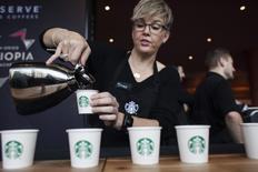 Sandy Roberts pours samples of Starbucks Reserve Sun Dried Ethiopia Yirgacheffe coffee during the company's annual shareholders meeting in Seattle, Washington, U.S. on March 19, 2014. REUTERS/David Ryder/File Photo