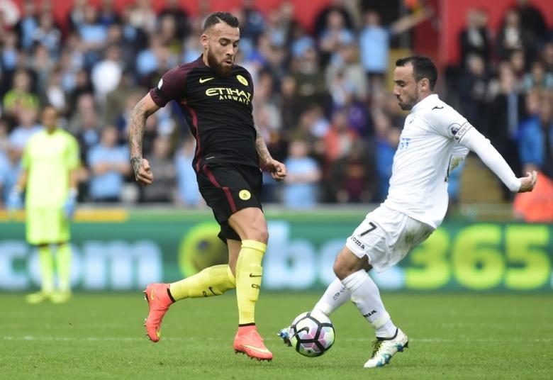 Britain Football Soccer - Swansea City v Manchester City - Premier League - Liberty Stadium - 24/9/16Swansea City's Leon Britton in action with Manchester City's Nicolas Otamendi Reuters / Rebecca Naden