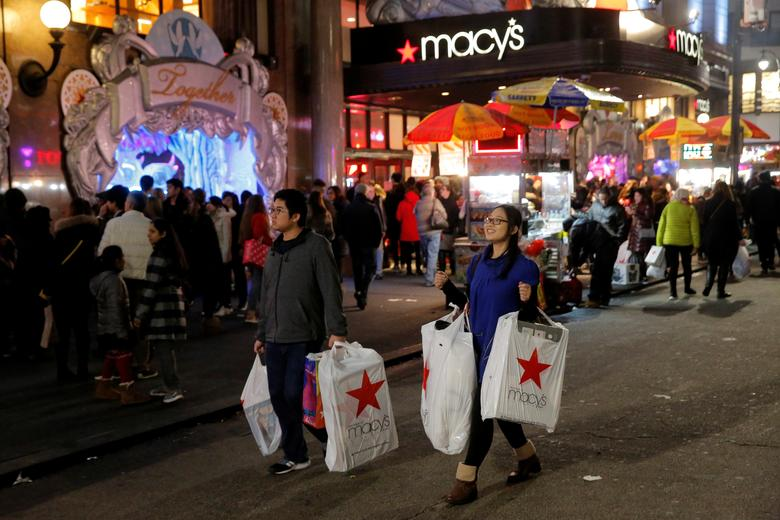 Shoppers exit Macy's Herald Square store during early opening for Black Friday sales in Manhattan, New York, U.S., November 24, 2016.  REUTERS/Andrew Kelly