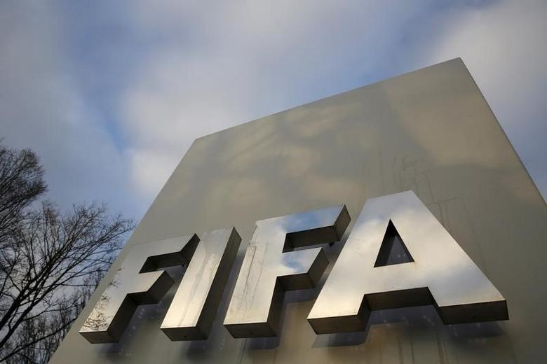 A FIFA sign is seen outside the FIFA headquarters in Zurich, Switzerland December 17, 2015. REUTERS/Ruben Sprich