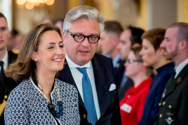 Belgium's Prince Laurent (R) and Princess Claire attend a tribute to the victims of Brussels suicide attacks, at the royal palace in Brussels, Belgium, May 22, 2016. REUTERS/Danny Gys/Pool