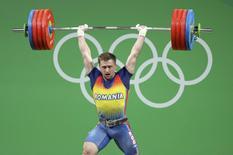 2016 Rio Olympics - Weightlifting - Final - Men's 85kg - Riocentro - Pavilion 2 - Rio de Janeiro, Brazil - 12/08/2016. Gabriel Sincraian (ROU) of Romania competes. REUTERS/Stoyan Nenov