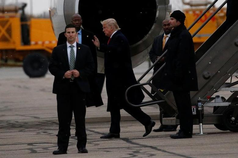 U.S. President-elect Donald Trump waves after arriving at John Glenn Columbus International Airport in Columbus, Ohio, U.S., December 8, 2016. REUTERS/Shannon Stapleton