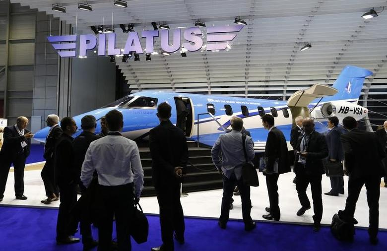 Visitors look at an Pilatus P24 aircraft replica during the European Business Aviation Convention & Exhibition (EBACE) at Cointrin airport in Geneva, Switzerland, May 24, 2016.  REUTERS/Denis Balibouse