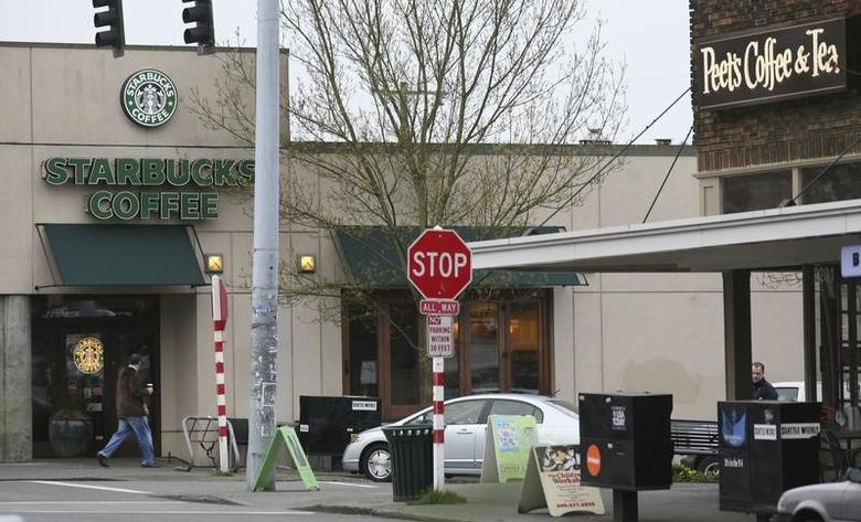 File Photo: A Starbucks store is seen a Peets Coffee and Tea store (R) in Seattle, Washington March 19, 2008. REUTERS/Marcus R. Donner
