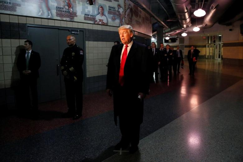 U.S. President-elect Donald Trump speaks with the media after meeting with families of the victims of the November 28 attacks at Ohio State University in The Jerome Schottenstein Center in Columbus, Ohio, U.S., December 8, 2016. REUTERS/Shannon Stapleton