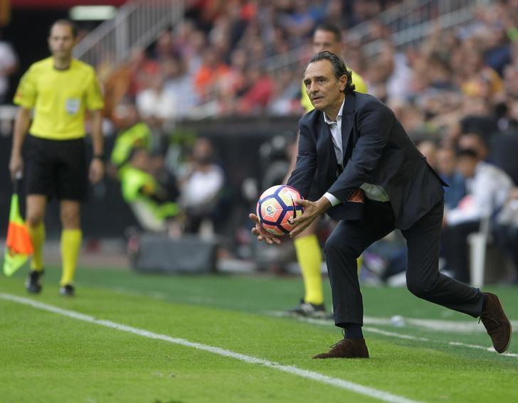 Football Soccer - Spanish Liga - Valencia v Barcelona - Mestalla Stadium - Valencia, Spain, 22/10/16. Valencia's coach Cesare Prandelli catches a ball. REUTERS/Heino Kalis