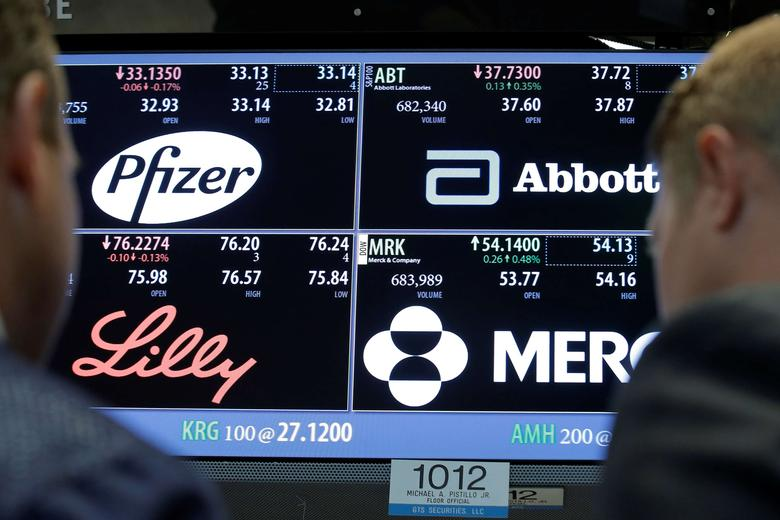 A screen displays trading information for stocks; Pfizer, Abbott Laboratories, Merck and Company and Eli Lilly and Company on the floor of the New York Stock Exchange (NYSE) in New York City, U.S., May 16, 2016.  REUTERS/Brendan McDermid/File Photo