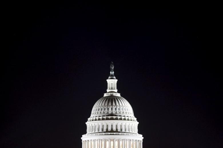 The U.S. Capitol dome is pictured in the pre-dawn darkness in Washington in this file general view photo taken October 18, 2013.    REUTERS/Jonathan Ernst/Files