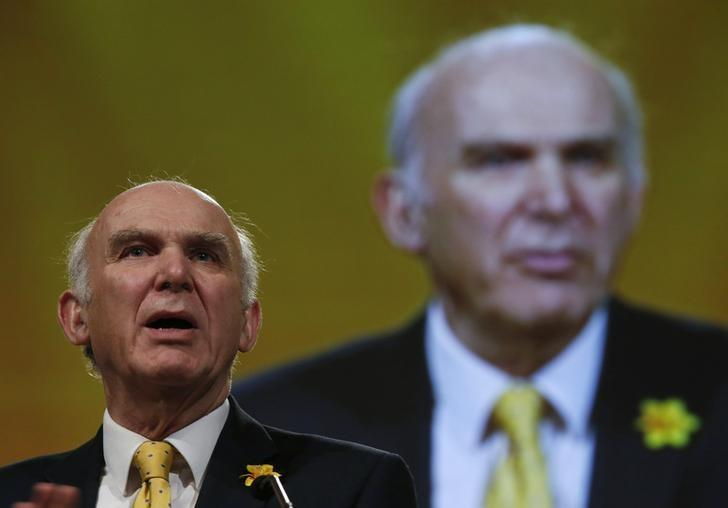 FILE PHOTO: Vince Cable during a keynote speech on the second day of Liberal Democrat party's spring conference in Liverpool, northern England, March 14, 2015.  REUTERS/Phil Noble/Files