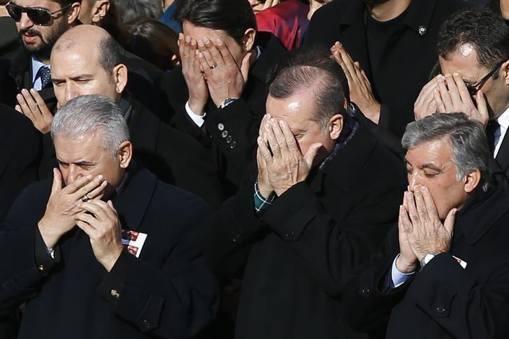Turkish Prime Minister Binali Yildirim, President Tayyip Erdogan and Former President Abdullah Gul pray during a ceremony for police officers killed in Saturday's blasts in Istanbul, Turkey, December 11, 2016. REUTERS/Murad Sezer