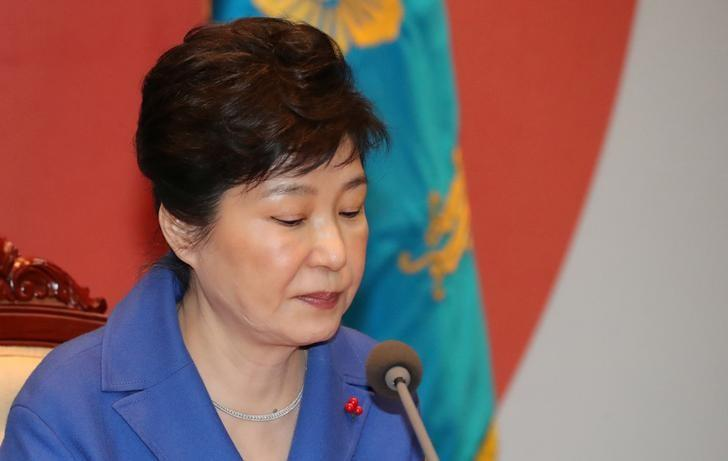 South Korean President Park Geun-hye speaks during an emergency cabinet meeting at the Presidential Blue House in Seoul, South Korea, December 9, 2016. Yonhap/ via REUTERS