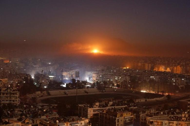 Smoke and flames rise after air strikes on rebel-controlled besieged area of Aleppo, as seen from a government-held side, in Syria December 11, 2016. REUTERS/Omar Sanadiki
