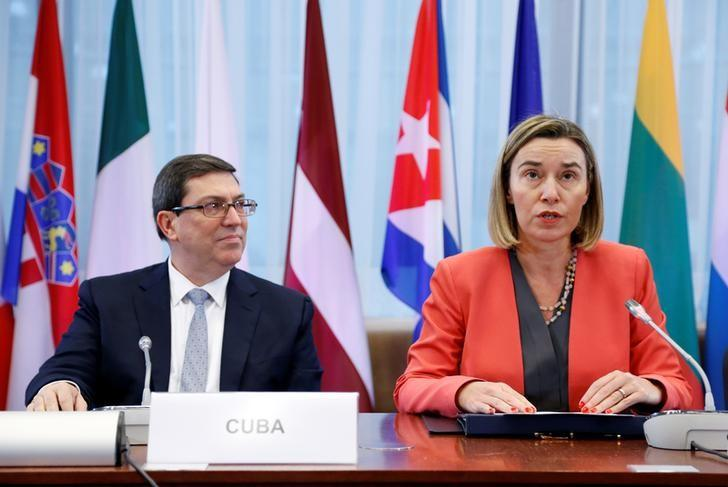 Cuba's Foreign Minister Bruno Rodriguez and European Union foreign policy chief Federica Mogherini attend a signing ceremony of a EU-Cuba Political Dialogue and Cooperation Agreement in Brussels, Belgium December 12, 2016.  REUTERS/Francois Lenoir