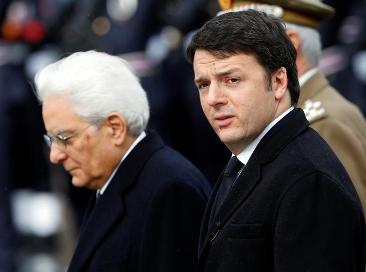 File picture shows Italian Prime Minister Matteo Renzi (R) and Italy's newly elected president Sergio Mattarella as they arrive at the Unknown Soldier's monument in central Rome, February 3, 2015. REUTERS/Remo Casilli/Files