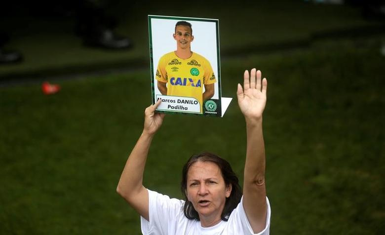 Alaide, mother of Chapecoense goalkeeper Danilo holds a picture of her son who was a victim of the plane crash in Colombia, after a ceremony to pay tribute to Chapecoense players at Arena Conda stadium in Chapeco, Brazil, December 3, 2016.   REUTERS/Ricardo Moraes