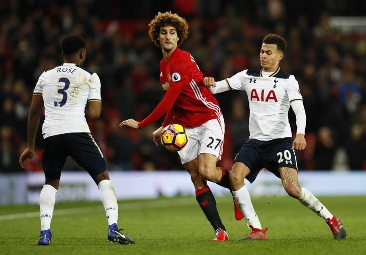 Football Soccer Britain - Manchester United v Tottenham Hotspur - Premier League - Old Trafford - 11/12/16 Manchester United's Marouane Fellaini in action with Tottenham's Dele Alli    Action Images via Reuters / Jason Cairnduff Livepic