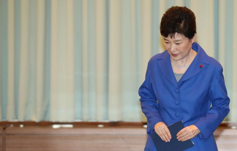 South Korean President Park Geun-hye arrives to attend an emergency cabinet meeting at the Presidential Blue House in Seoul, South Korea, December 9, 2016. Yonhap/ via REUTERS
