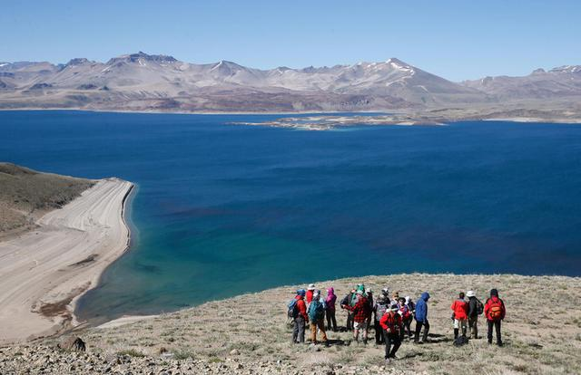 Scientists and geologists are seen during an international meeting of geological and volcanological study at the Laguna del Maule (Lagoon of Maule) in the VII region of Talca, south of Santiago,  Chile  November 29, 2016. REUTERS/Rodrigo Garrido