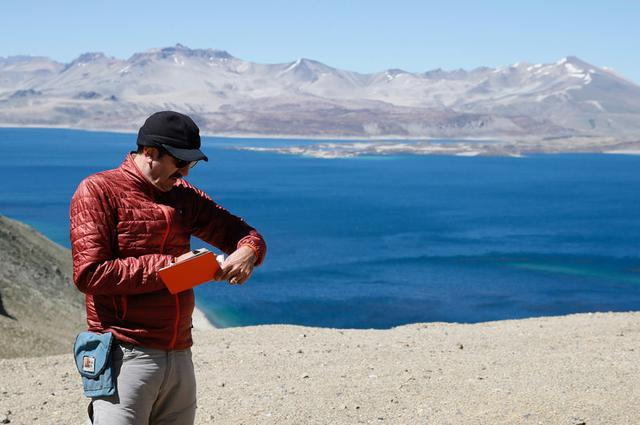 U.S. scientist and geologist of the university of Wisconsin,  Brad Singer takes notes of his studies and geological analyses in the Laguna del Maule (Lagoon of Maule in the VII region of Talca, south of Santiago,  Chile  November 29, 2016. REUTERS/Rodrigo Garrido