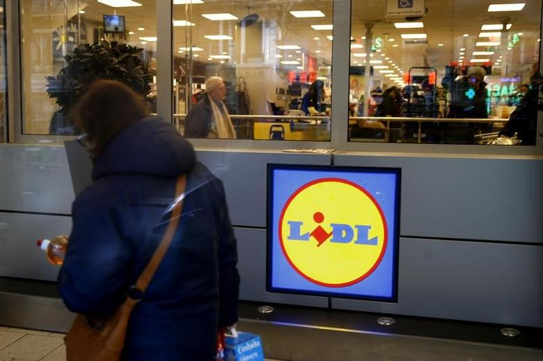 A woman walks past a logo inside a store of discount supermarket chain Lidl in Paris, France, March 1, 2016. REUTESR/Philippe Wojazer