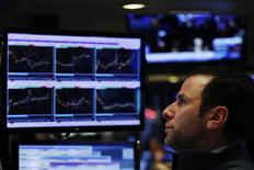 A trader watches his screen on floor of the New York Stock Exchange (NYSE) shortly before the close of trading in New York, U.S., December 13, 2016.  REUTERS/Lucas Jackson