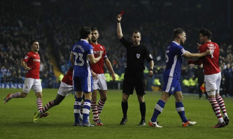 Referee Peter Bankes appears to send off Sheffield Wednesday's Sam Hutchinson before sending off Barnsley's Adam Hamill (R). Sheffield Wednesday v Barnsley - Sky Bet Championship - Hillsborough - 13/12/16. Action Images / Lee Smith Livepic