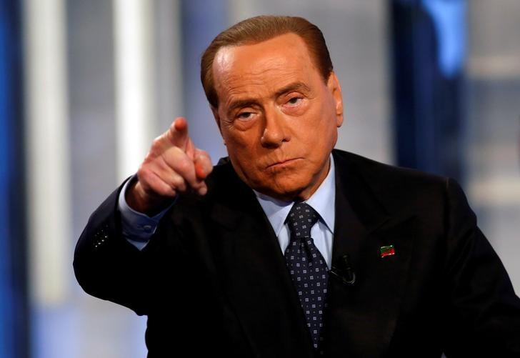 Italy's former Prime Minister Silvio Berlusconi gestures as he attends television talk show ''Porta a Porta'' (Door to Door) in Rome, Italy, November 30, 2016. REUTERS/Remo Casilli/Files